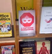A Copyright Masquerade in the window of Economists Bookshop, London, March 2014