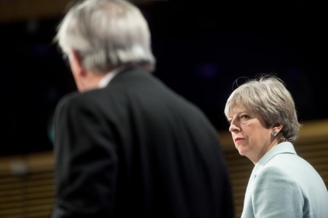 Theresa May with Jean-Claude Juncker at Brussels press conference after Brexit negotiations in 2017